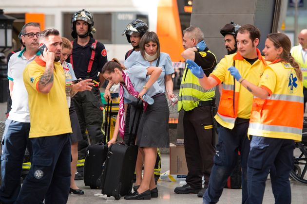 Emergency service workers and train crew at the scene of the