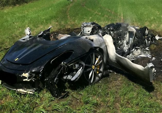 The car left the road in wet conditions and slid across a field before bursting into
