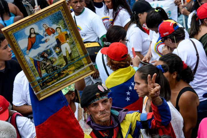 A supporter of Venezuelan President Nicolas Maduro demonstrates in Caracas during the closing of the campaign to elect the me