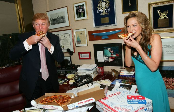 "The most recently fired contestant on ""The Apprentice"" Stephanie Myers, delivers Domino's New American Classic Cheeseburger Pizza to Donald Trump at his office in Trump Tower on April 1, 2005 in New York City."