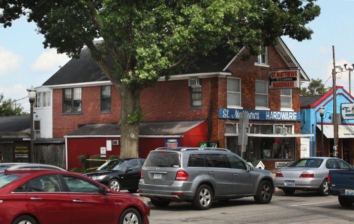 "The ""signature"" oak in St. Matthews, a suburb of Louisville, before it was felled last weekend."