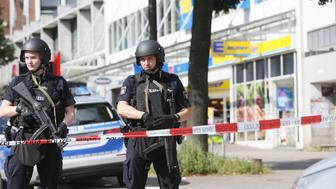 Police cordon off the area around a supermarket in the northern German city of Hamburg, where a man killed one person and wounded several others in a knife attack, on July 28, 2017 .  'There is no valid information yet on the motive or the number of people injured' by the man, who 'entered a supermarket and suddenly began attacking customers', said police, adding that one victim died from his severe wounds. / AFP PHOTO / dpa / Paul Weidenbaum / Germany OUT        (Photo credit should read PAUL WEIDENBAUM/AFP/Getty Images)