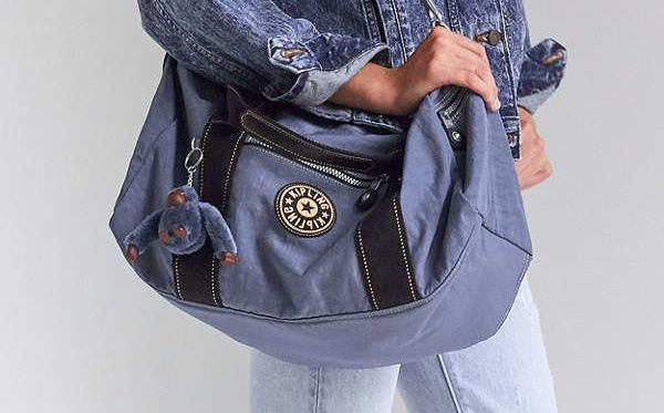 "<a href=""https://www.urbanoutfitters.com/brands/kipling"" target=""_blank"">This collection</a>&nbsp;is the first in a series of throwback collaborations between Kipling and Urban Outfitters."