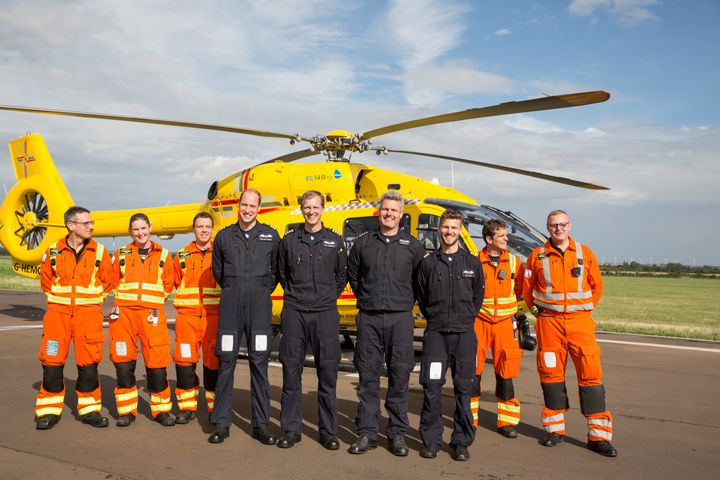 Prince William poses for a final photo with both day and night shift crews during his final shift with the East Anglian Air Ambulance (EAAA) at Cambridge Airport, Britain on July 27.