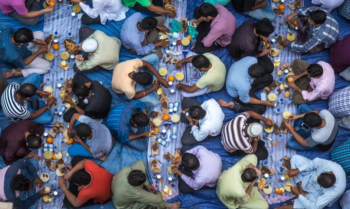 Muslims eat an evening meal called iftar after the sun sets during Ramadan.