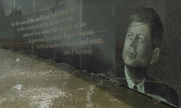 "Image of Kennedy at the Kennedy Space Center, calling for the moon and planets beyond to have ""a banner of freedom and peace."