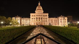 Texas State Capitol Building In Downtown Austin, TX At Night. Photo of the State Capitol Building taken from the north side.