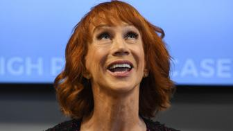 Comedian Kathy Griffin gestures during a news conference to discuss the comedian's 'motivation' behind a photo of her holding what appeared to be a prop depicting US President Donald Trump's bloodied, severed head, with her attorney, Lisa Bloom in Woodland Hills, California on June 2, 2017. / AFP PHOTO / Mark RALSTON        (Photo credit should read MARK RALSTON/AFP/Getty Images)