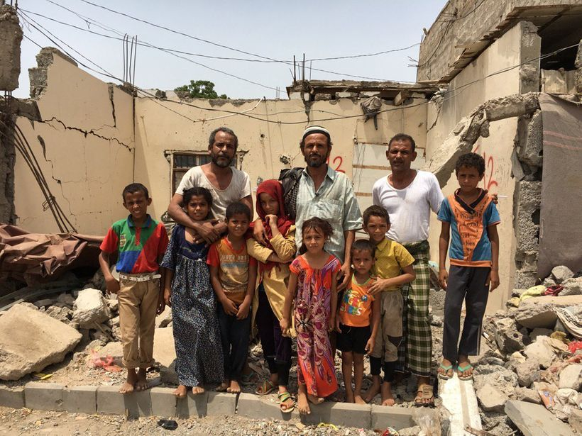 "Aden Yemen - ""The Awal family in the wreckage of their home - hit by two Saudi air strikes. Some of them still live in the ru"