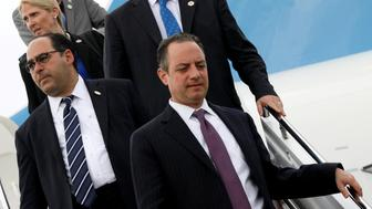 White House Chief of Staff Reince Priebus (R) and fellow staff members arrive with U.S. President Trump aboard Air Force One at Long Island MacArthur Airport in Ronkonkoma, New York, U.S. July 28, 2017. REUTERS/Jonathan Ernst     TPX IMAGES OF THE DAY