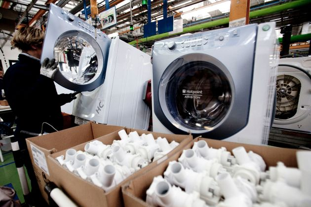 An Indesit Company SpA employee assembles a washing machine at the company's factory in Comunanza, Italy....