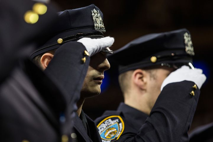 New York Police Department recruits salute during the NYPDgraduation ceremony at Madison Square Garden in New York City