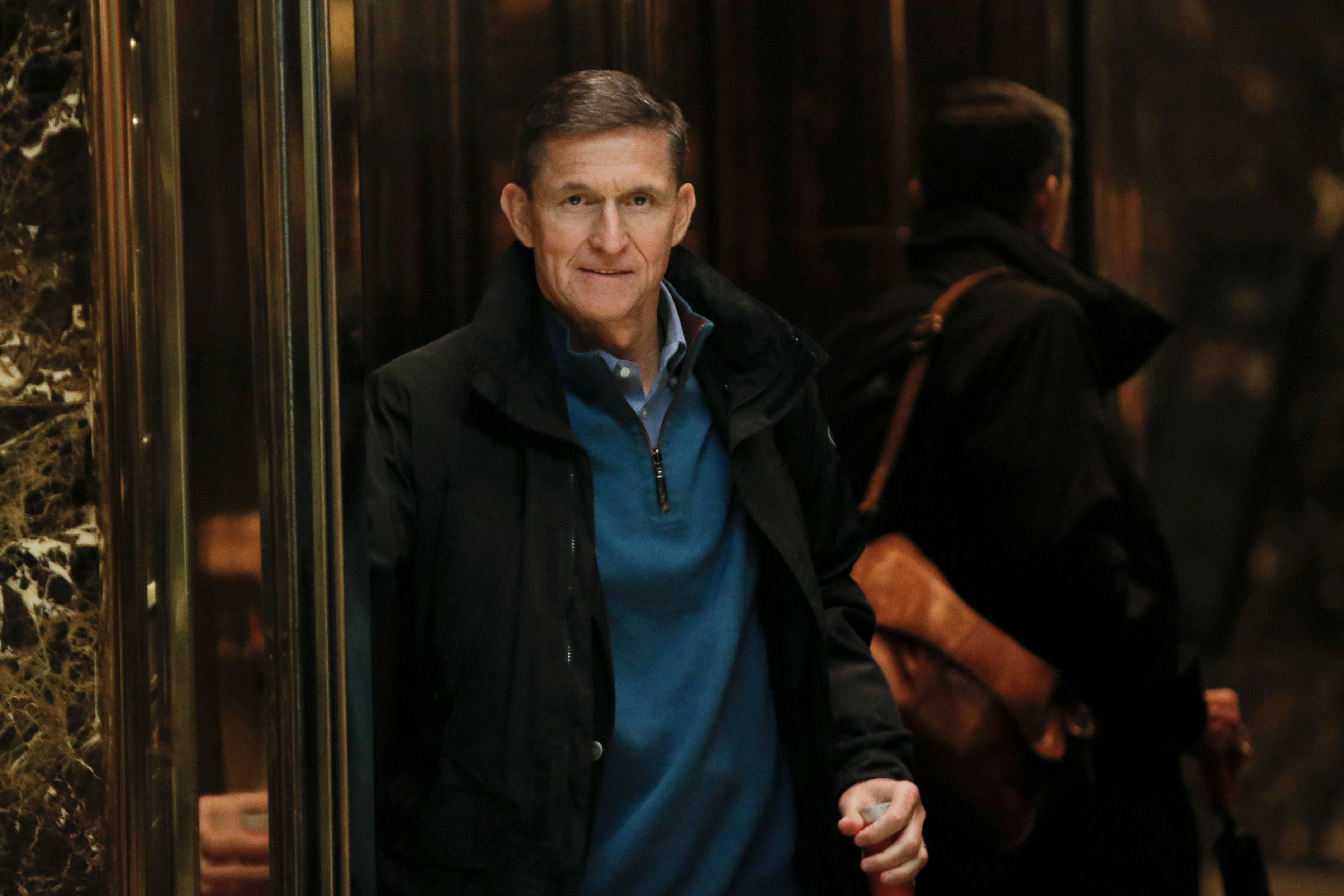 Retired Lt. Gen. Michael Flynn boards an elevator as he arrives at Trump Tower in New York City on Nov....