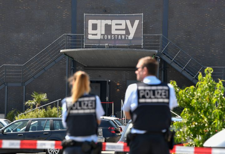 Policemen stand in front of the Grey Club in Konstanz, southern Germany, where a gunman opened fire, killing one and wounding
