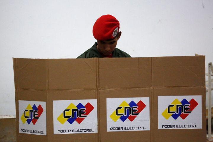 A soldier casts his ballot during the Constituent Assembly election in Caracas, Venezuela, July 30, 2017.