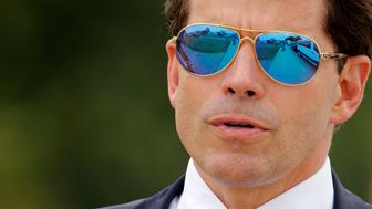 White House Communications Director Anthony Scaramucci accompanies U.S. President Donald Trump for an event about his proposed U.S. government effort against the street gang Mara Salvatrucha, or MS-13, with a gathering of federal, state and local law enforcement officials in Brentwood, New York, U.S. July 28, 2017. REUTERS/Jonathan Ernst