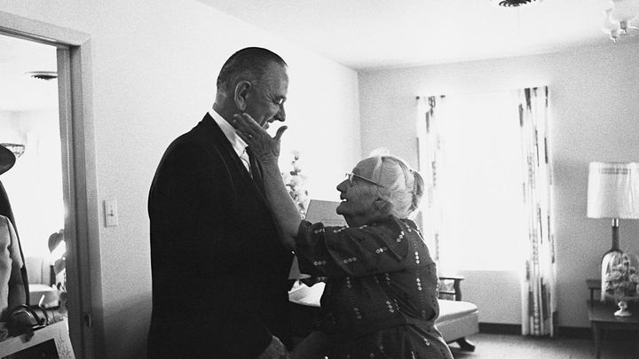An elderly woman shows her gratitude to President Lyndon B. Johnson for his signing of the Medicare health care bill in July
