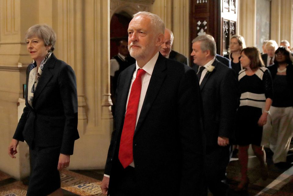Theresa May and Jeremy Corbyn walk through the Peers Lobby during the State Opening of Parliament by...