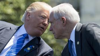 US President Donald Trump speaks with Attorney General Jeff Sessions (R) during the 36th Annual National Peace Officers Memorial Service at the US Capitol in Washington, DC, May 15, 2017. / AFP PHOTO / SAUL LOEB        (Photo credit should read SAUL LOEB/AFP/Getty Images)