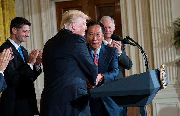 Foxconn and U.S. Chief Executives joined by Paul Ryan celebrate the deal. Are they sharing a laugh at the expense of American