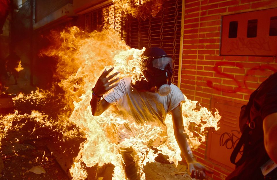 A demonstrator catches fire during clashes with riot police on May 3, 2017. Protests against the government of beleaguered le