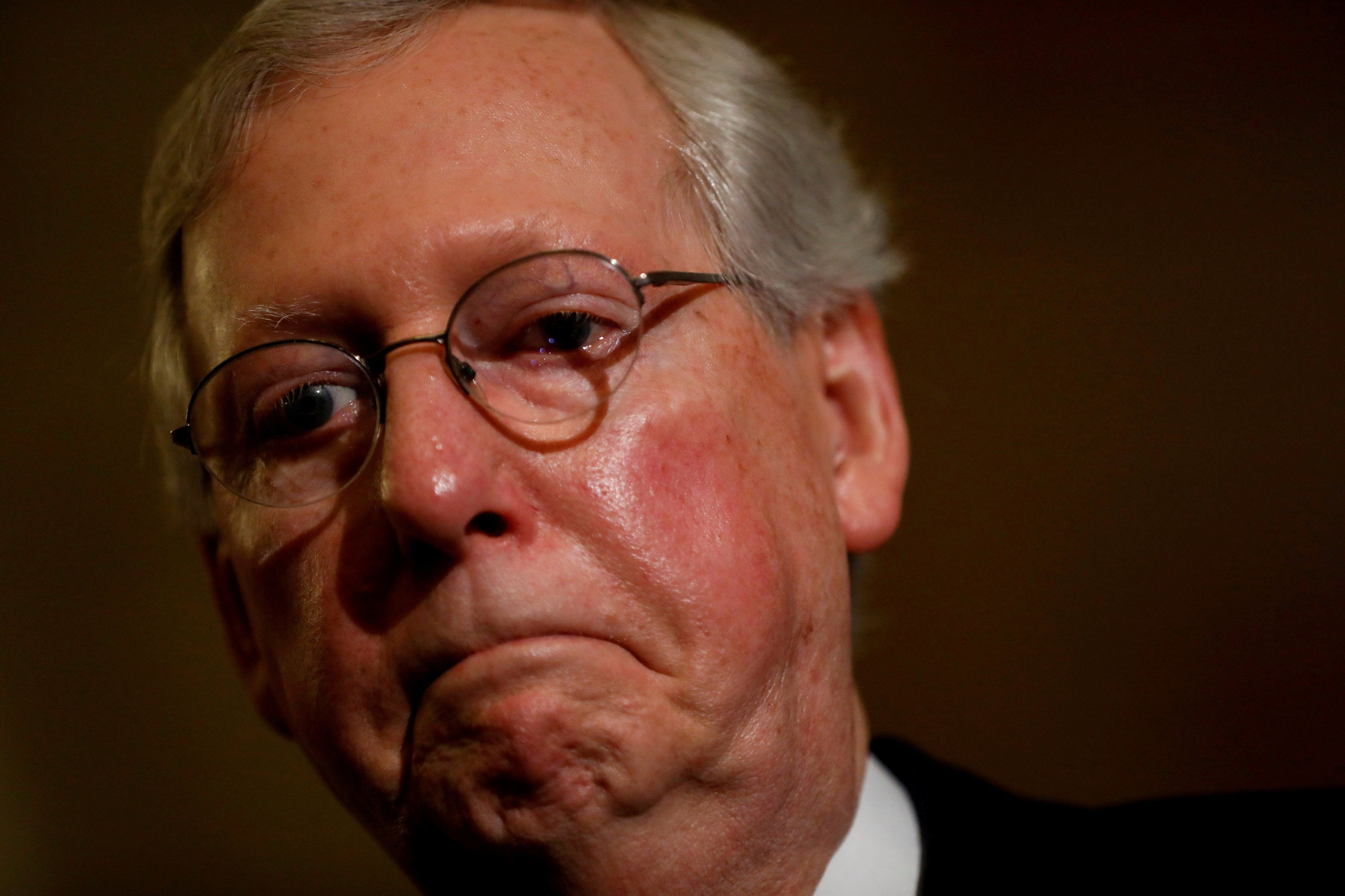 Senate Majority Leader Mitch McConnell speaks with reporters following the successful vote to open debate on a health care bill on Capitol Hill in Washington, U.S., July 25, 2017. REUTERS/Aaron P. Bernstein     TPX IMAGES OF THE DAY