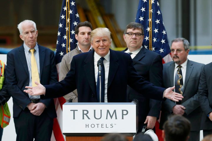 Then-presidential candidate Donald Trump speaks to the media during a news conference at the construction site of the Trump I