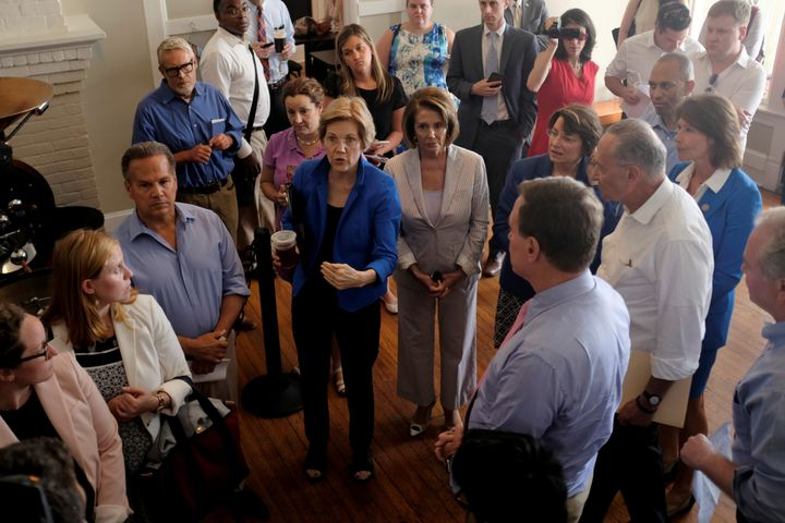 "Democratic lawmakers huddle together in a coffee shop before unveiling their party's ""A Better Deal"" for working America"
