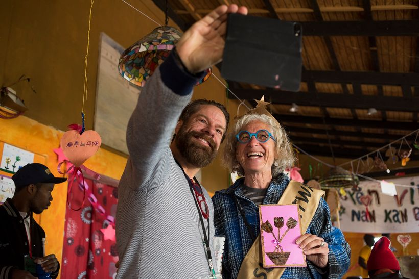 <strong>Martin Brouillette and Dr. Jane Aronson pose for a selfie in Martin's art workshop, Kan Etwal, Kenscoff, Haiti.</stro