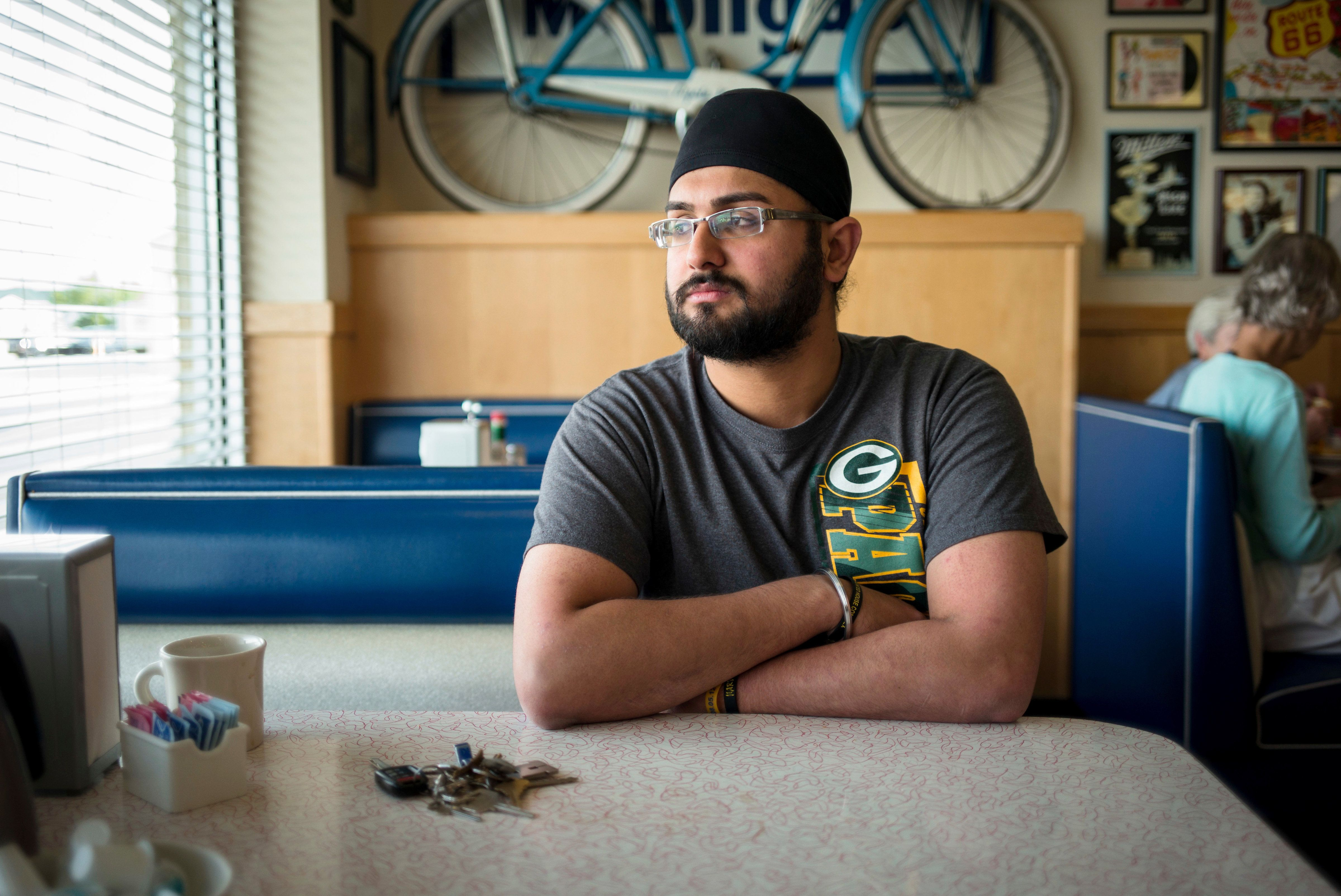 Hapreet Singh who lost his mother in the Sikh Temple massacre sits for a portrait at the Douglas Avenue Diner Friday July 28, 2017 Racine , WI .Aug 5th marks the 5 year anniversary at the Sikh Temple in Oak Creek, Wisconsin, where Wade Michael Page a know white supremacist  fatally shot six people and wounded four others before dying himself.  CREDIT: Darren Hauck for The HuffintonPost