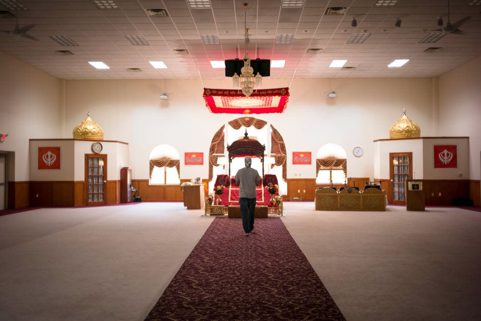 Sikhs come to pray and pay their respects at the Sikh Temple of Wisconsin on July 28, 2017.