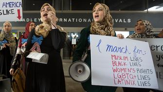 LOS ANGELES, CA - FEBRUARY 04: Women demonstrate in support of a ruling by a federal judge in Seattle that grants a nationwide temporary restraining order against the presidential order to ban travel to the United States from seven Muslim-majority countries, at Tom Bradley International Terminal at Los Angeles International Airport on February 4, 2017 in Los Angeles, California. (Photo by David McNew/Getty Images)