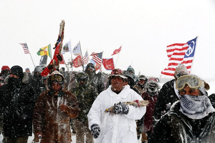 Veterans and other activists march in December 2016 against plans to pass the Dakota Access pipeline adjacent to the Standing