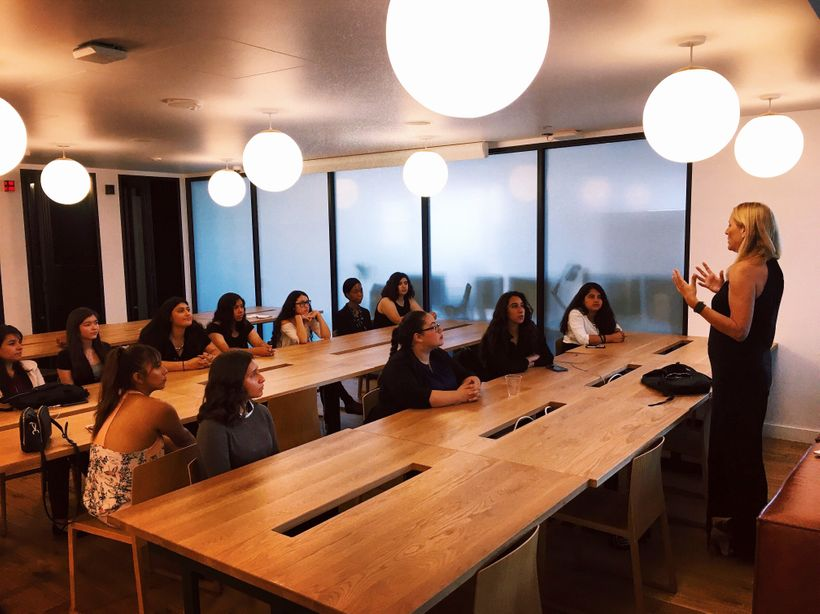 <em>Lisa Hennessy coaching at the nonprofit MOSTe on personal professional branding.</em>