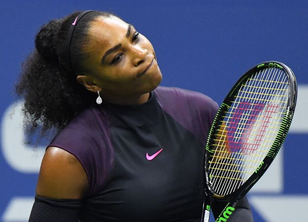 Serena Williams reacts after a missed shot against Karolina Pliskova of the Czech Republic on day eleven...