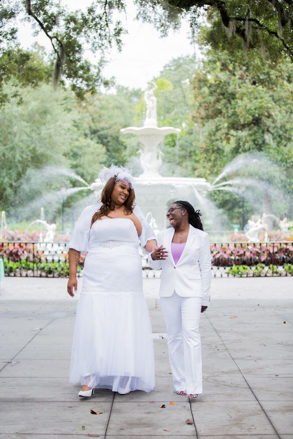 """Carmen and Natalie were married July 17 at Forsyth Park in Savannah, Georgia."" -- <i><a href=""https://www.savannahcustomwedd"