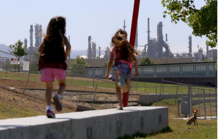 Children at play in Wilmington, California—their neighborhood is adjacent to a major cluster of industry.