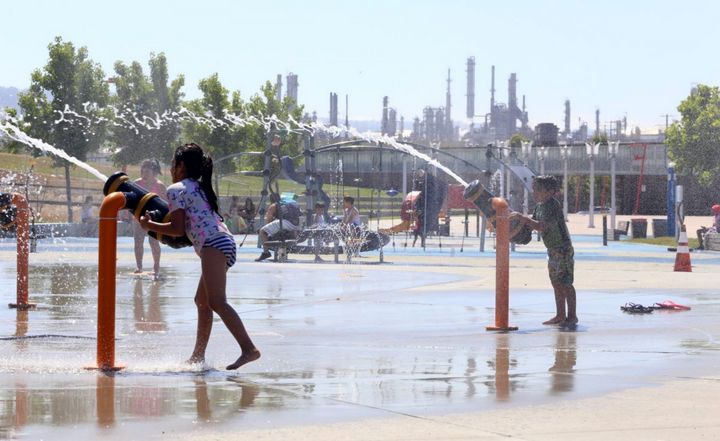 At new Waterfront Park, children play between the Valero and Phillips 66 refineries, right beside the Los Angeles Port.
