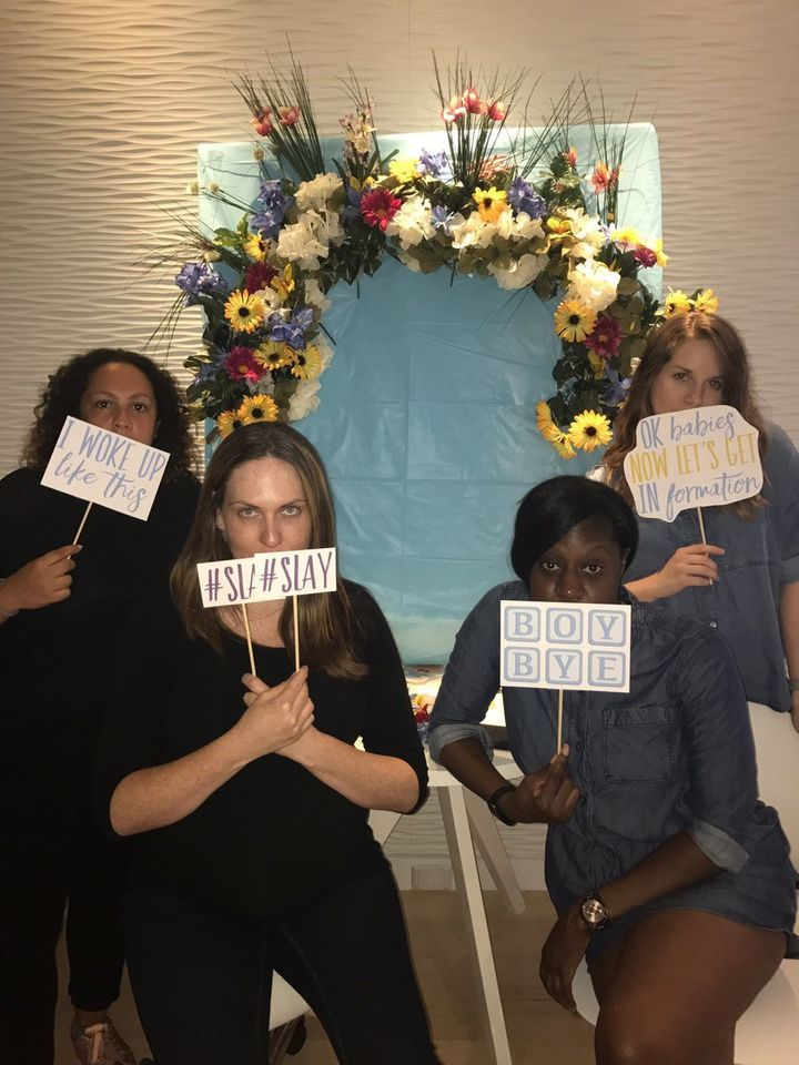 "Riley Andreu, who helped organize the shower, created photo booth signs that included sayings like, ""I woke up like this"" and"