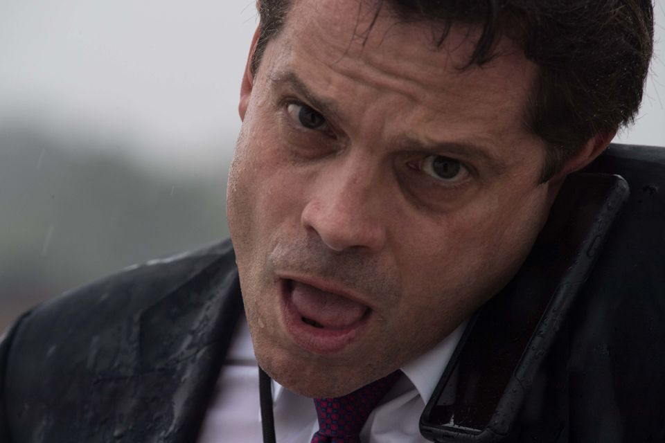 Anthony Scaramucci, then the White House communications director, speaks on the phone as he boards Air Force One at Andrews A