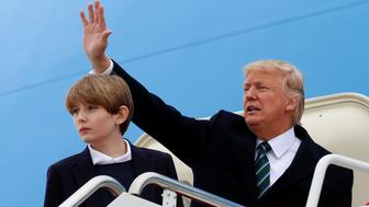 U.S. President Donald Trump and his son Barron board Air Force One to depart Joint Base Andrews in Maryland, U.S., on their way to Florida March 17, 2017.  REUTERS/Kevin Lamarque