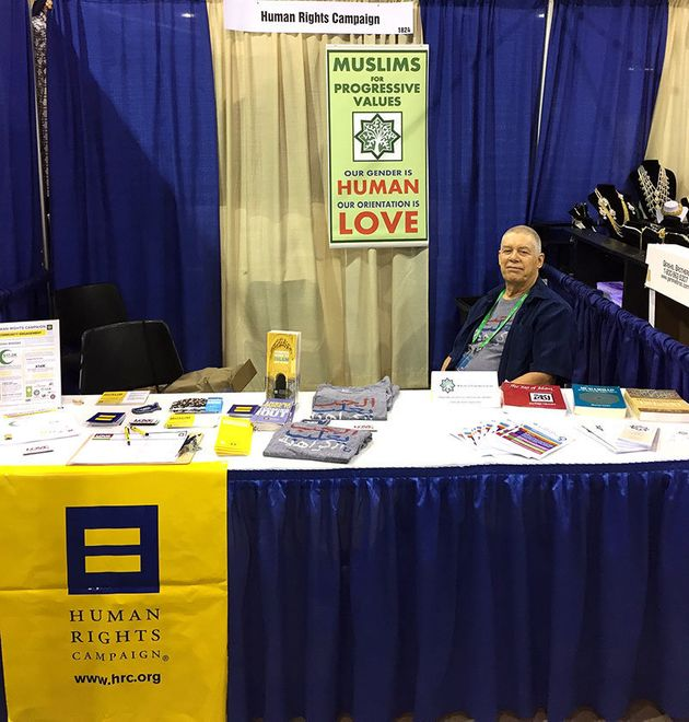 Frank Parmir, founder of MPV-Columbus, managing a booth organized by Muslims for Progressive Values and...