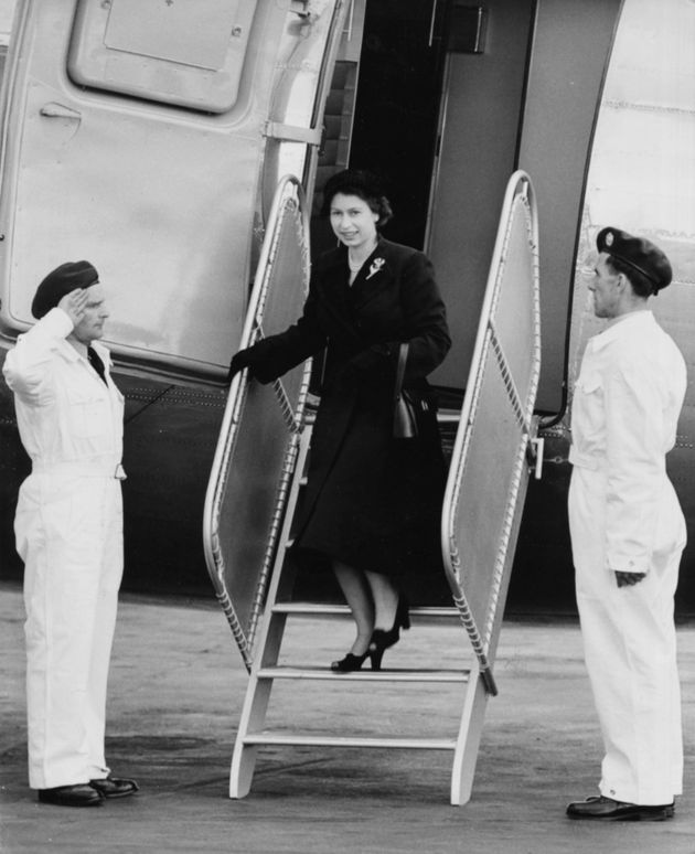 Queen Elizabeth II is saluted by the crew as she leaves her Viking airplane of the King's Flight, London...
