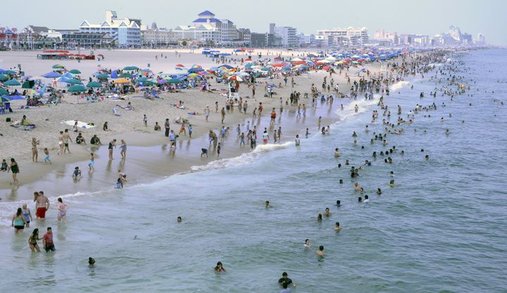 Sunbathers crowd the beach in Ocean City, Maryland. On Monday, police said they found a woman's body along the shore.