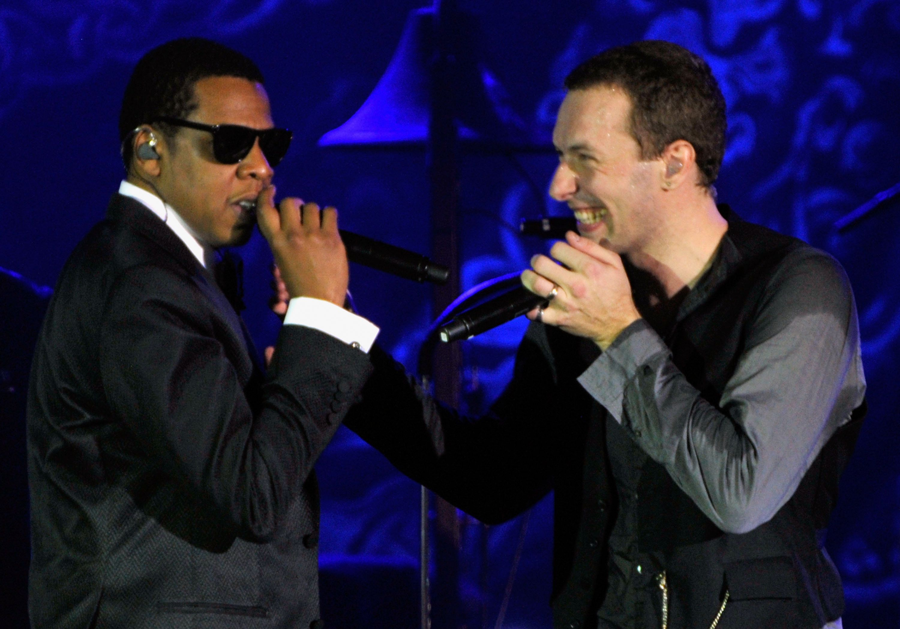 Rapper Jay-Z (L) performs onstage with musician Chris Martin (R) of the band Coldplay at The Cosmopolitan Grand Opening and New Year's Eve Celebration with Jay-Z and Coldplay at Marquee Nightclub in The Cosmopolitan on December 31, 2010 in Las Vegas, Nevada.