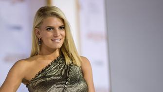 """Actress Jessica Simpson poses at the premiere of """"The Hunger Games: Mockingjay - Part 1"""" in Los Angeles, California November 17, 2014. The movie opens in the U.S. on November 21. REUTERS/Mario Anzuoni  (UNITED STATES - Tags: ENTERTAINMENT)"""