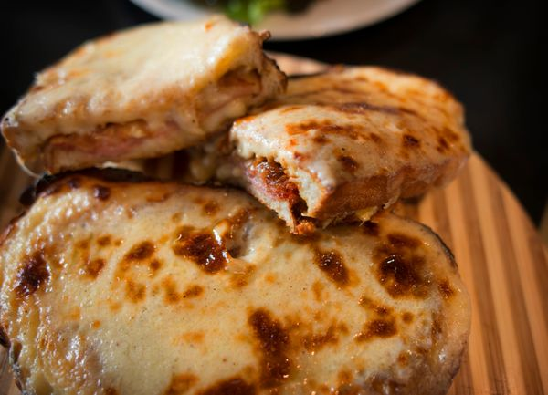 This classic French dish should be on more brunch menus. It's a grilled ham and cheese sandwich topped with béchamel s