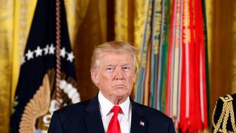 U.S. President Donald Trump awards the Medal of Honor to James McCloughan, who served in the U.S. Army during the Vietnam War, during a ceremony at the White House in Washington, U.S. July 31, 2017.  REUTERS/Joshua Roberts