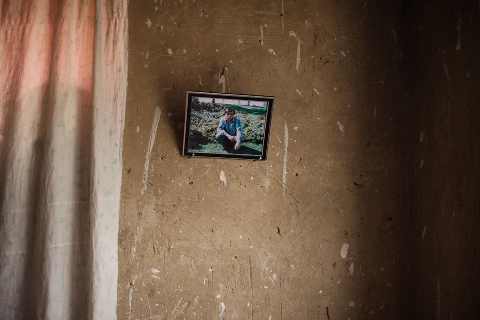 A photo of Khadem, Zakia's late husband, hangs on her wall. He died in a traffic accident 11 years ago, leaving her to s
