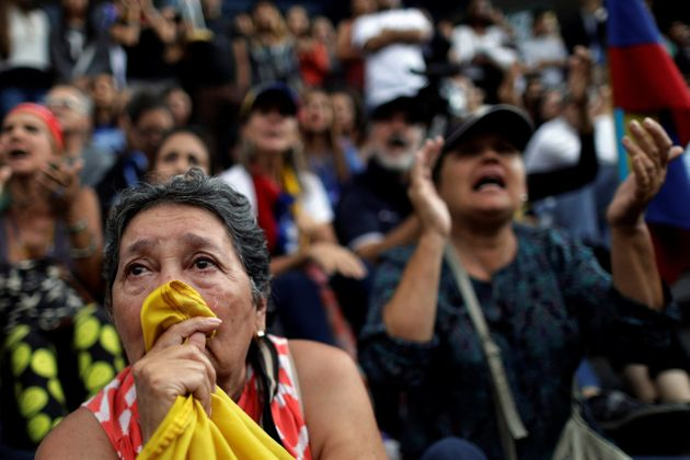 Opposition supporters pay tribute to victims of violence in protests against Venezuelan President Nicolas...